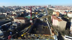 Aerial View of a Crane Carrying Construction Material in a Subway Construction Stock Footage