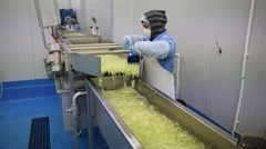 A wide oan and tilt shot of chopped lettuce washing process Stock Footage