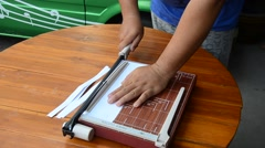 Man use Paper Cutter Stock Footage