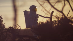 4K Astronaut walking in woodland area looking for signs of life - stock footage