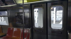 elevated subway train interior, panning across empty seats inside carriage in NY - stock footage