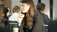 4K Portrait of young girl talking to friends in school cafeteria - stock footage