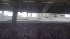 Subway view of graffiti on gritty Brooklyn wall from moving B train in NYC Stock Footage