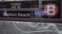 Sign for B train Harlem 145th St Brighton Beach Brooklyn moving train window NYC Stock Footage