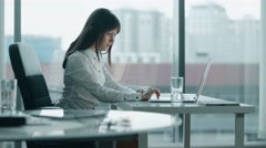 Young business woman working at a laptop in modern office. she stop because back Stock Footage