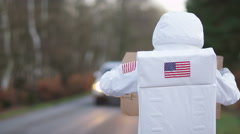 4K Astronaut returned to earth trying to hitch a ride from passing traffic - stock footage