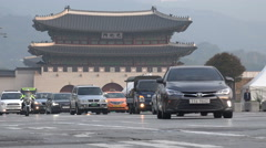 Modern traffic contrasts with ancient traditional temple in Seoul, South Korea - stock footage