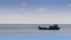 Vietnamese Fishing Boat Drifts along Sea against Horizon Stock Footage