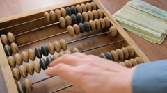 accountant with abacus - stock footage