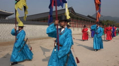 Traditional changing of the guard ceremony at palace in Seoul Stock Footage