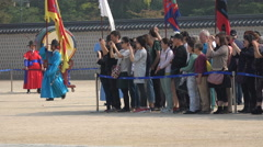 Tourists take pictures of guard changing ceremony at royal palace in South Korea Stock Footage