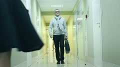 creative director walking down the corridor in modern office building - stock footage