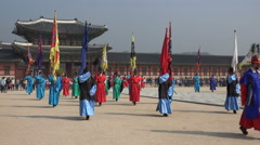 Parade of colorfully dressed royal palace guards in Seoul, South Korea Stock Footage