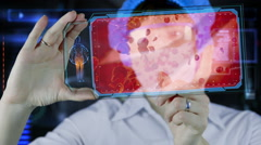 Doctor with futuristic hud screen tablet. Red blood cell, eritrocite. future Stock Footage
