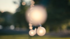 Rack Focus of String Lights at an outdoor party Stock Footage