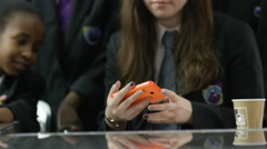4K Young girls in school cafeteria pose to take a selfie with mobile phone - stock footage