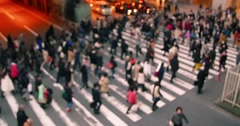 Business people walking Out of focus crossing at busy street in Japan Stock Footage