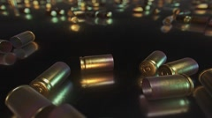 Close Up of Bullet Casings on Reflective Surface Stock Footage