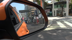 Mirror view of a taxi driving through central Seoul, South Korea Stock Footage
