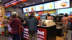 People order hamburgers in the Korean fast food restaurant chain Lotteria Stock Footage