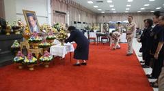 Thais gather around a portrait of the King Bhumibol Adulyadej Stock Footage
