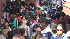 Crowds of people visit a busy popular shopping district in Seoul, South Korea Stock Footage