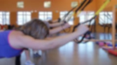 A group doing TRX training in a gym Stock Footage