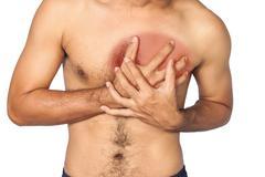 Young man having heart attack Stock Photos
