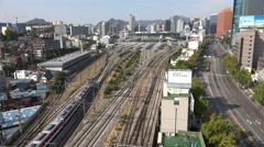 Seoul station, city skyline, major transport hub in South Korea Stock Footage