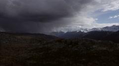 Ominous Alpine Mountain Storm Pan Right 4K Stock Footage