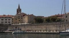 Sailing into port in Alghero, Sardinia Stock Footage