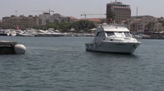 Sailing into Meditteranean harbor with boat passing Stock Footage