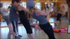 Group doing TRX training in a gym Stock Footage