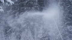 Snow cannon in a snow dust. Snowmaking is the production of snow by forcing Stock Footage