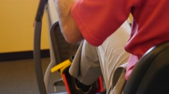 Man using a sitting stair machine in gym Stock Footage