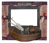 Unusual photo frame. Fishing boat with oars and fish - stock photo