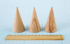 Wooden geometric shape cone - stock photo