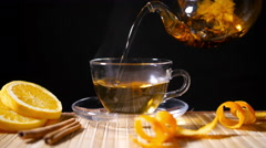 Pouring Blooming Tea with Cinnamon and Orange 4K - stock footage