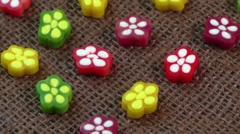 Colorful candies on brown background - stock footage
