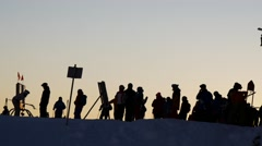 Silhouette of people at a ski resort, sunset Stock Footage