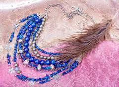 Blue lapis lazuli necklace from natural gemstones Stock Photos