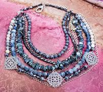 Above view of gray blue necklace from gem stones Stock Photos