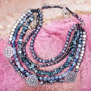 Top view of gray blue necklace from gemstones Stock Photos