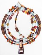 African style necklace from gemstones and coconut Stock Photos