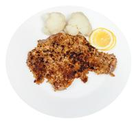 fried veal schnitzel, boiled cauliflower, lemon - stock photo