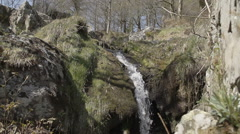 Pretty Waterfall In An Ancient Woodland In Rural Wales Stock Footage