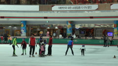 Kids practice short track speed skating in Seoul, a popular sport in South Korea Stock Footage