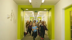 4K Portrait of happy diverse group of children in school hallway Stock Footage