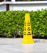 Yellow sign caution wet floor - stock photo