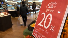 Discount advertising 'Korean Grand Sale' in supermarket Seoul Stock Footage